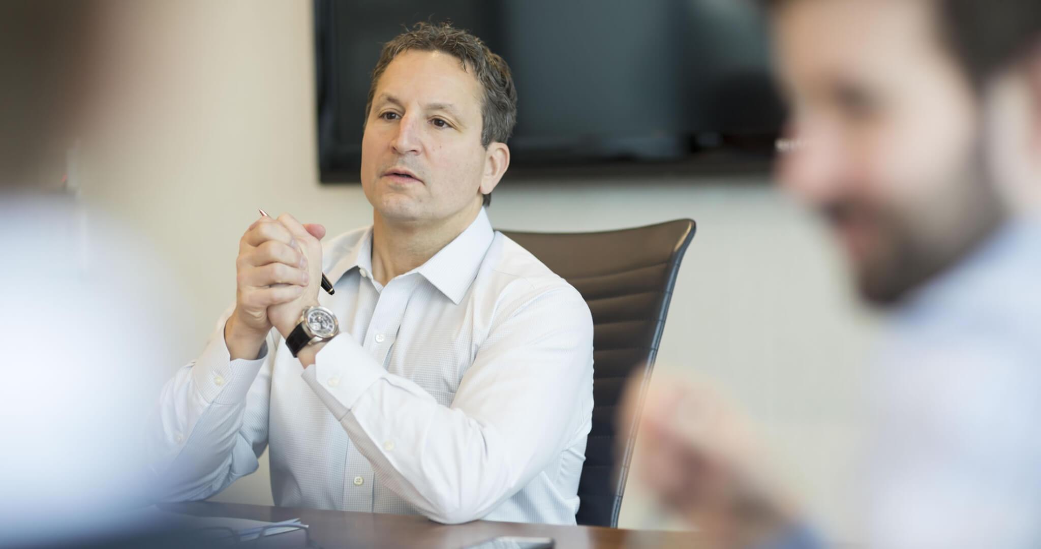 David Herro in a meeting