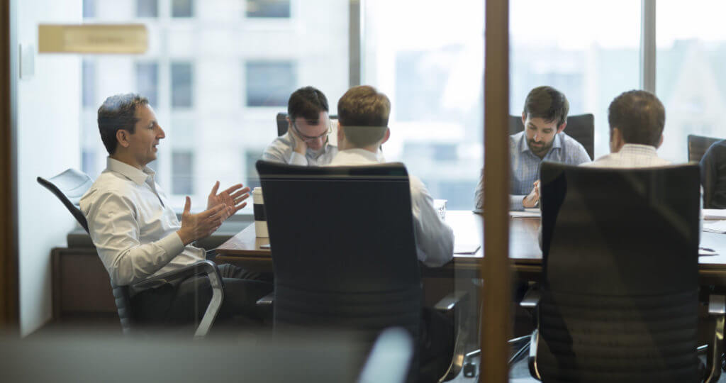 David Herro in a meeting with his team