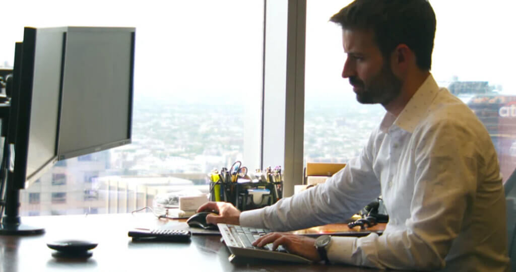 Justin Hance- Portfolio Manager- working at his desk